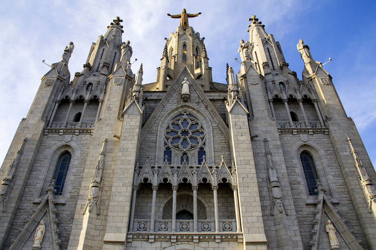 Bottom view of the Church of the Sacred Heart of Jesus, located on the top of Mount Tibidabo in Barcelona, Catalonia, Spain Architecture Low Angle View Building Exterior Built Structure Sky Belief Religion Place Of Worship Spirituality Building History The Past Travel Destinations Travel Façade No People Arch Ornate Gothic Style Tibidabo Tibidabo's Church Cathedral Tibidabo Cathedral Del Sagrat Cor My Best Photo
