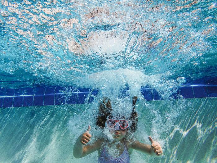 Girl gesturing in swimming pool