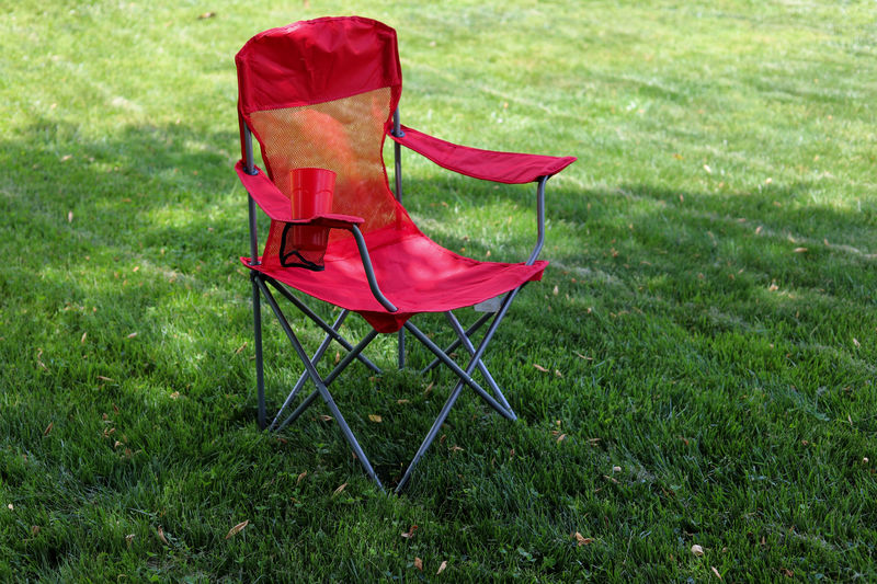 Empty chair on grassy field