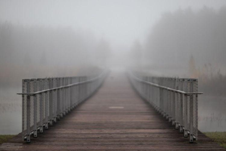 Bridge over foggy weather