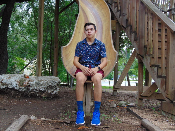 Thoughtful young man sitting on slide