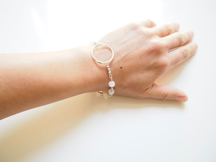 Hand Arm Soft Light Arm EyeEm Selects Human Hand Hand Human Body Part One Person Jewelry Adult Indoors  Close-up Women White Background Finger Bracelet Body Part Personal Accessory Lifestyles Human Finger