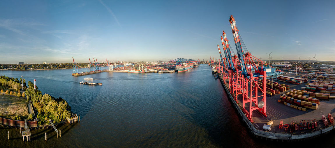 Large panorama of the port of hamburg at sunset