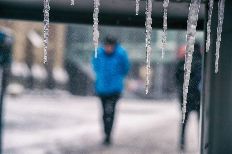 Defocused image of man standing outdoors