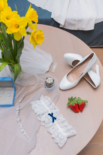 High angle view of bouquet on white table