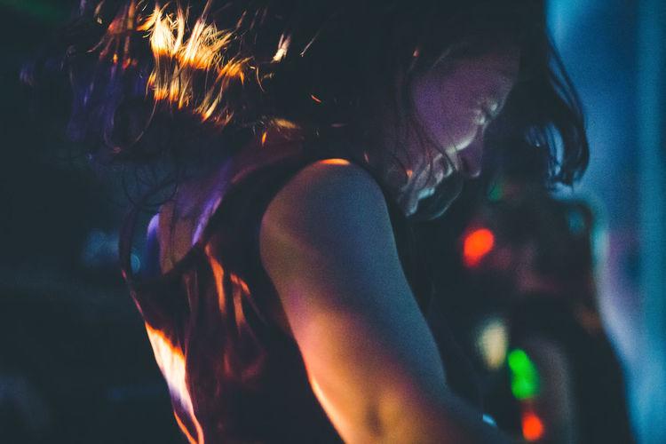 Happy Woman Dancing At Nightclub