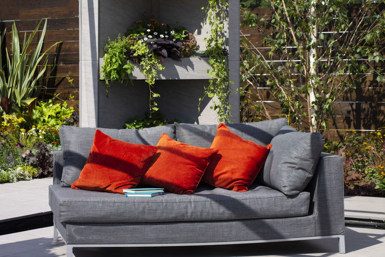 Potted plants on sofa at yard