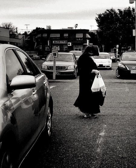 Nun Streetphotography Blackandwhite Bnw Mobilephotography Mpro Iphone6 Car Transportation Land Vehicle Real People Rear View Mode Of Transport Full Length Street Women Outdoors Walking Road Lifestyles Men Day Built Structure Building Exterior Architecture Tree City