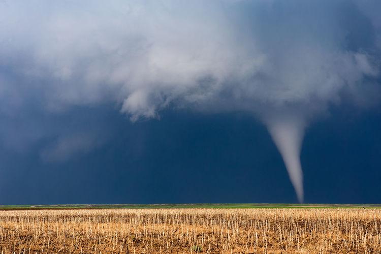A tornado develops beneath a supercell thunderstorm near bushnell, nebraska.