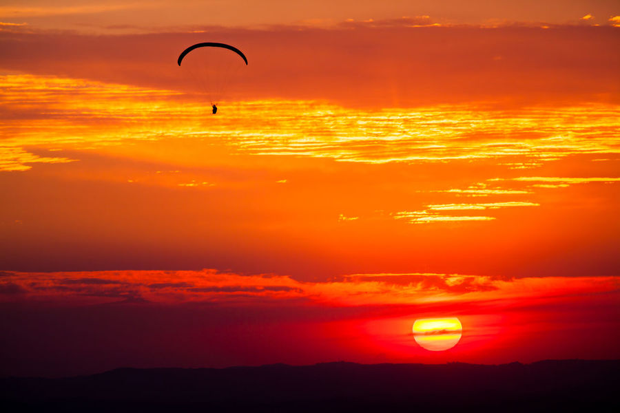 Fly Freedom Hang Gliding Nature Paragliding Adventure Adventure Sports Beauty In Nature Flight Flying Mid-air Mountain Nature Orange Color Outdoors Radical Sport Scenics Silhouette Sky Sports Success Sun Sunset Wind Wings