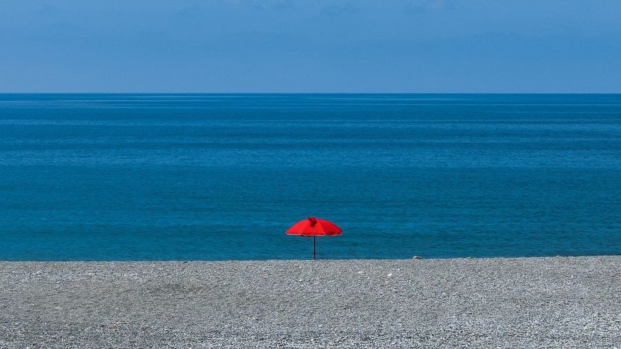 Red Sea Water Horizon Over Water Horizon Beauty In Nature Scenics - Nature Blue Red Nature Land Tranquil Scene Outdoors No People Umbrella Day Sky Beach Tranquility Protection