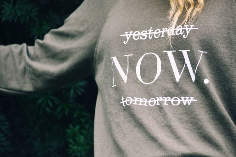 Now Text Close-up Outdoors Day People Casual Clothing Real People Front View Fashion Word Words Wisdom Words Of Wisdom... Live Now Now Young Adult One Person Single Word Communication Message Text