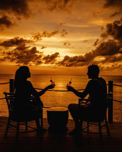 Couple Couple Travelling Men St Lucia Man Sunrise Saint Lucia Travel Couple Beach Boy Colourful Tropical Cocktail Cocktail Time Sunset Sunset Silhouettes Friendship Photography Themes Young Women Sea Water Sunset Togetherness Beach Sitting Drink Tropical Drink Martini Glass Horizon Over Water Beach Party Hard Liquor
