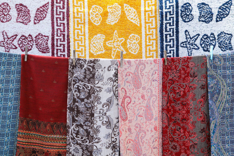 Greek folk patterns on cloths hanging on a string Pattern Textile Full Frame Multi Colored Close-up Choice Variation No People Backgrounds Red Indoors  Design For Sale Textured  Side By Side Retail  In A Row Business Clothing Store Retail Display Cloth Shell Pattern