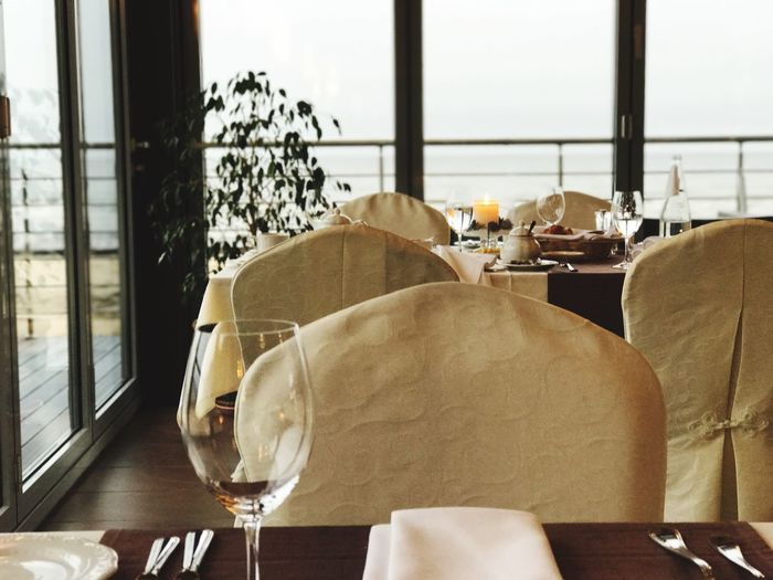 EyeEm Selects Table Indoors  Chair Window Restaurant Wineglass Dining Table Home Interior No People Place Setting Luxury Napkin Drinking Glass Day Wine Seat Food Close-up