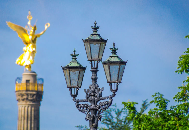 An Eye For Travel Siegessäule  Architecture Blue Built Structure Clear Sky Day Gas Light Goldene Else Lighting Equipment Low Angle View Nature No People Outdoors Sky Statue Street Lamp Street Light Travel Destinations Tree