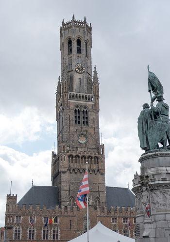 Belfort van Brugge (Bruges Belfry) in Grote Markt on an overcast day.Bruges Belfry in the town centre. Belfort Belfort Van Brugge Brugge Architecture Bell Tower Building Exterior Built Structure Human Representation Travel Destinations