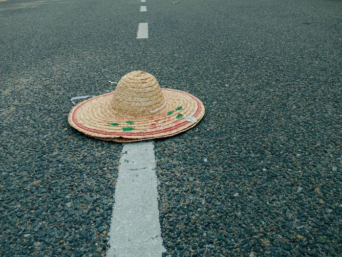 High angle view of hat on road