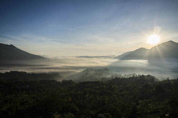 Sunrise in Bali Bali Beauty In Nature Day Hazy  Idyllic Landscape Mountain Mountain Peak Nature No People Outdoors Remote Scenics Silhouette Sky Sun Sunset Tranquil Scene Tranquility Tree