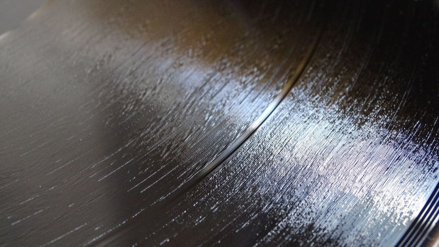 A macro photo of the groove of a vinyl record. Close-up Fragility Indoors  No People Vinyl Record Vinyl Record Groove Vinyl Record Macro