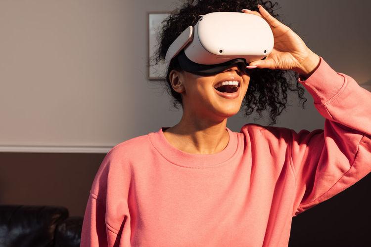 Smiling woman using virtual reality simulator