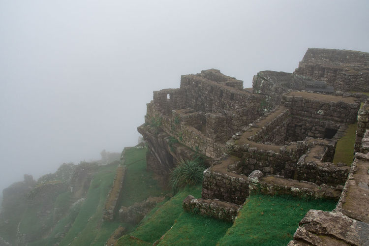 Fog Architecture Built Structure Sky Nature Day Ancient Old Ruin History No People Building Exterior The Past Travel Destinations Mountain Travel Old Tourism Outdoors Ancient Civilization Ruined Stone Wall Machu Picchu Inca Inca Ruins
