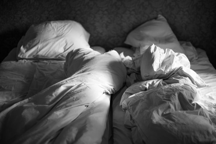 Empty unmade bed with white sheets duvets Bead Sprea Bead Spread Bed Bed Time Bedroom Black & White Black And White Duvet Empty Linnen No People Pillow Tranquility Unmade Bed Emptyness Loss Longing Missing You Missyou