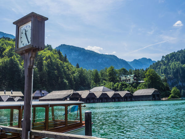 Königssee landscape Boats⛵️ Architecture Beauty In Nature Boathouses Built Structure Clock Mountain Nature Outdoors Scenics Sea Sky Tranquil Scene Tranquility Tree Water Wood - Material