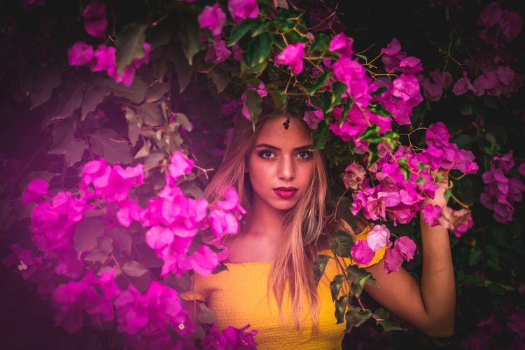Roxana saumell Flowering Plant Flower Plant One Person Portrait Pink Color Beauty Front View Young Women Looking At Camera Long Hair Beauty In Nature Beautiful Woman Young Adult Headshot Hair Women Leisure Activity Hairstyle Nature