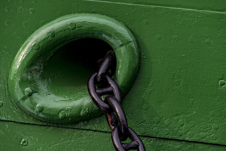 black anchor chain Anchor Black Anchor Chain Chain Close-up Connection Day Green Color Metal Museums Ship No People Old Ship Outdoors Ship's Side Strength