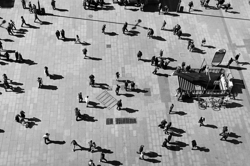 High angle view of people at plaza del callao on sunny day