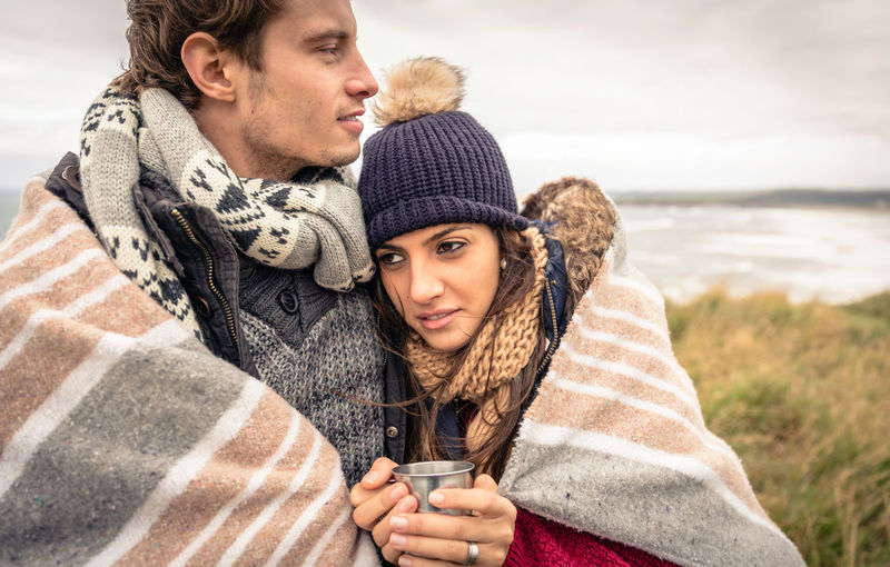 Couple Covered With Blanket