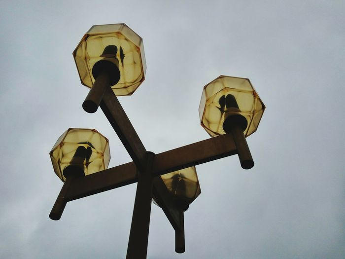 Low angle view of antique street light against sky