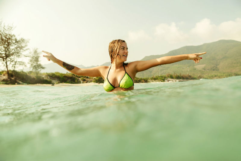 woman jump in sea waves splashing actively. Woman relax and swim in sea waves and relax. One Person Outdoors Sea Ocean Waves Wave Hot Summer ASIA Splash Splashing Water Drops Of Water Woman Sexygirl Sexywomen Happiness Leisure Activity Swimming Female Active Motion Blonde Jumping EyeEm Best Shots
