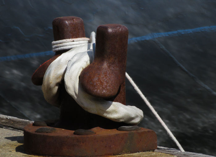 Close-up of rope tied on cleat