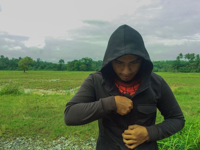 Be ready to be a superhero Real People Hooded Shirt One Person Front View Hood - Clothing Sky Lifestyles Young Adult Outdoors Cloud - Sky Grass Day People Adult Leisure Activity Nature Standing Tree Be. Ready.