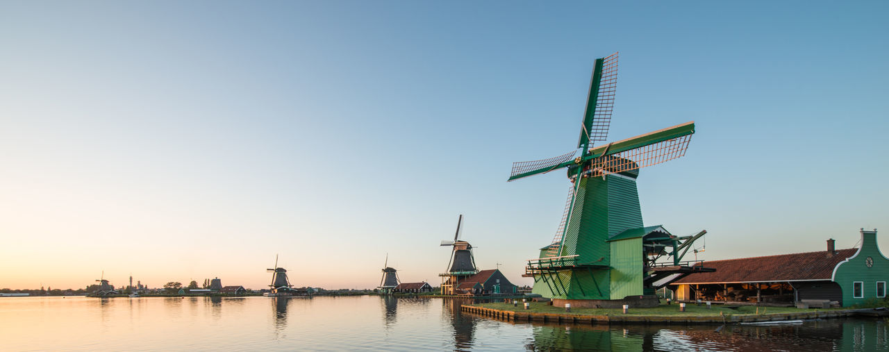 Zaanse schans, Holland - Traditional Dutch windmills with canal close Alternative Energy Blue Crane Crane - Construction Machinery Day Development Environmental Conservation Industry Nature No People Outdoors Renewable Energy Sky Traditional Windmill Water Wind Power Windmill