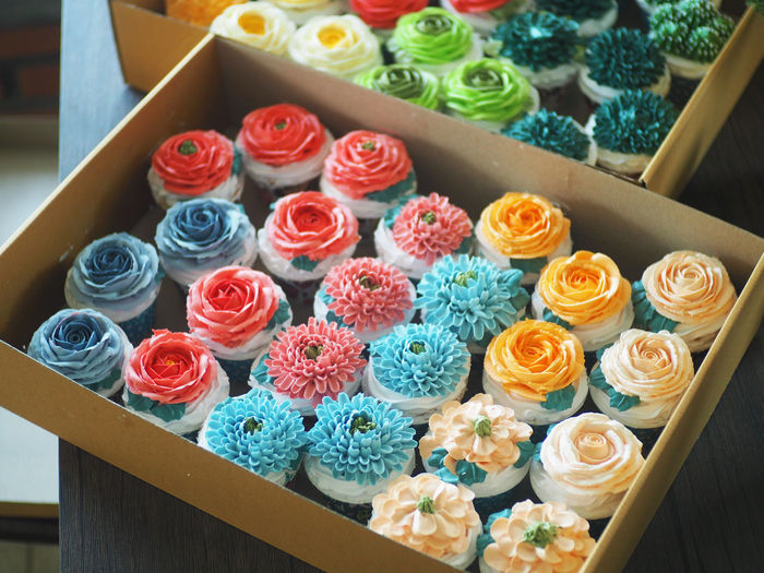 High angle view of multi colored roses on table