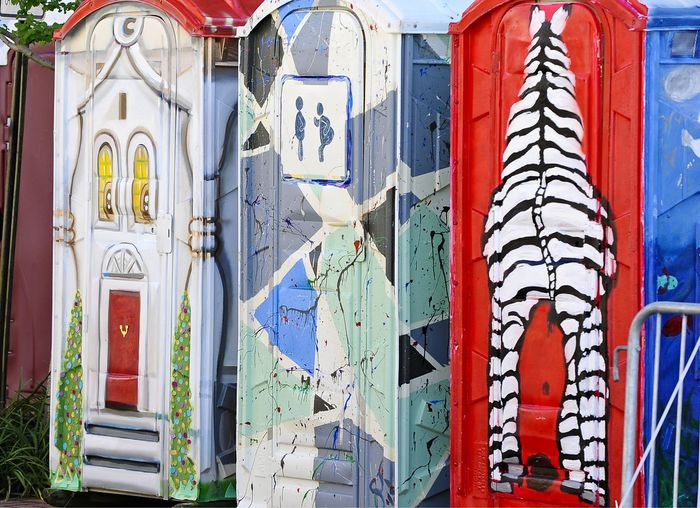Some very creative outdoor toilets at a Mississippi festival! Architecture Art Built Structure Closed Colorful Outdoor Toliets Culture Damaged Door Entrance Graffiti Mississippi Summer Old Ornate Religion Spirituality Text Wall Wall - Building Feature Weathered Wood Wooden