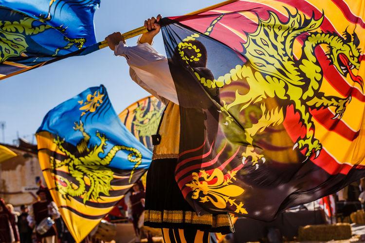 Man waving flag at parade