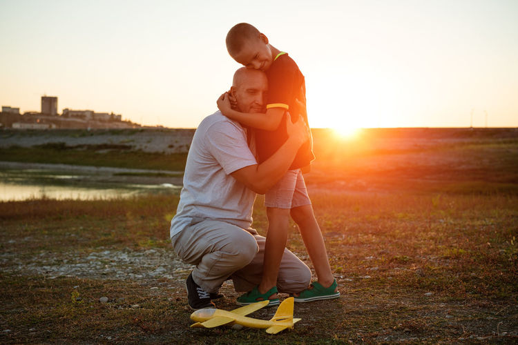Father's day. dad and little son play together outdoors