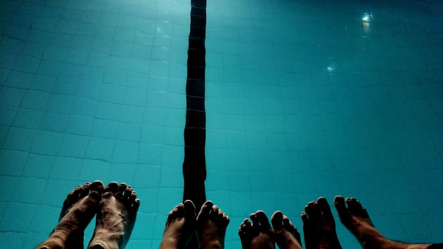 Feet Pool Water Foot Human Body Part Four Pairs Swimming Night Glow Lit Up EyeEm Selects Photography Themes Photo Messaging Crowd Low Section Mobile Phone Floating In Water Personal Perspective