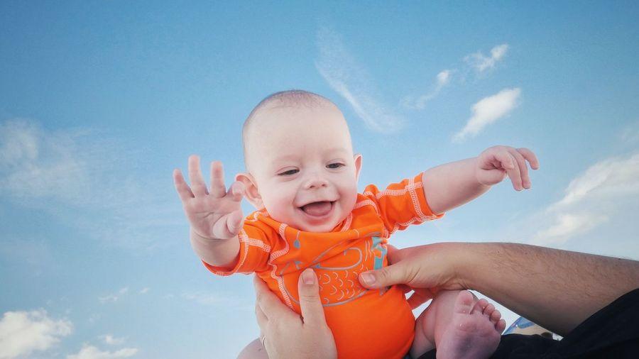 Happy Boy Playing Against Sky