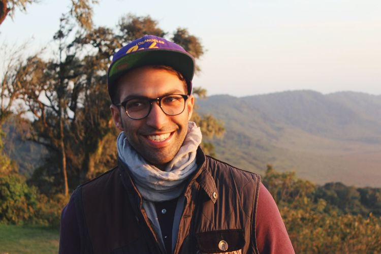 Portrait of young man standing on mountain