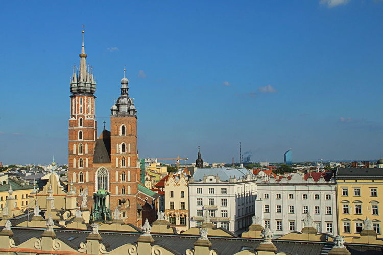 Basilica Cathedral Catholic Church City Break Gothic Architecture Blue Sky Building Exterior Built Structure Cityscape Cracow Day Famous Place History Krakow Landmark Main Square Medieval Architecture National Landmark No People Polish Tourism Tower Travel Destinations