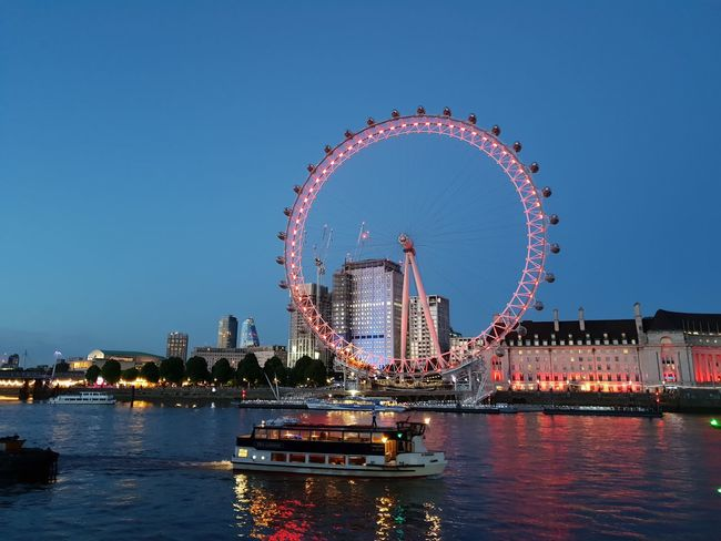 Ferris Wheel London Night Lights Night Photography Nightphotography River Thames River View Riverside Wheel Amusement Park Amusement Park Ride Architecture Blue Blue Sky Building Exterior Built Structure City Clear Sky Ferris Wheel Nature Night No People Outdoors River River Thames London River Thames Skyline River Thames At Night Sky Travel Travel Destinations Water Waterfront