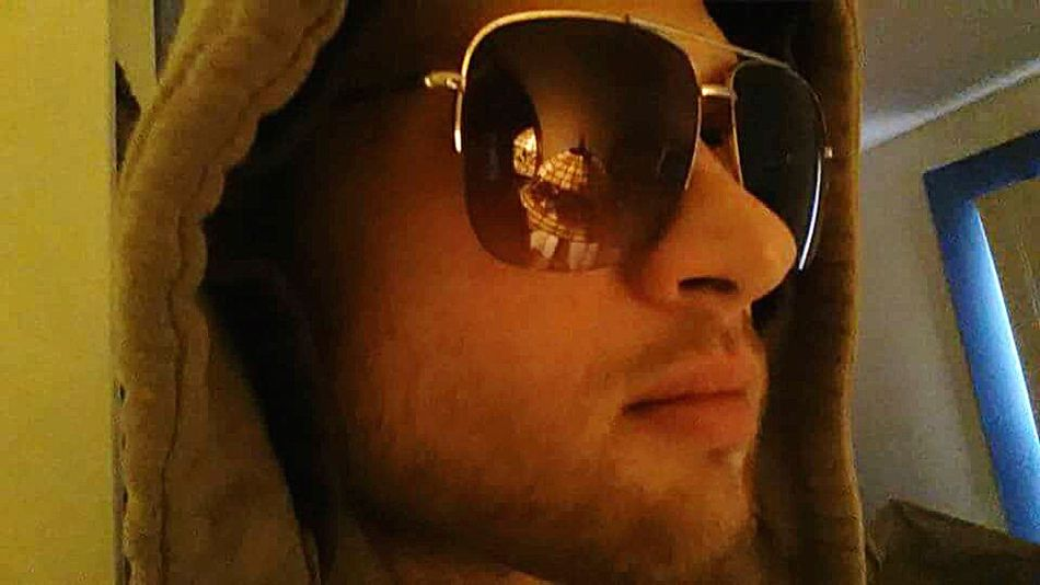 Sunglasses Hood Hoodie Irony Tiffany Lamp Indoors  One Person Adult Headshot Close-up People Perspective Contemplation. Thinking Looking