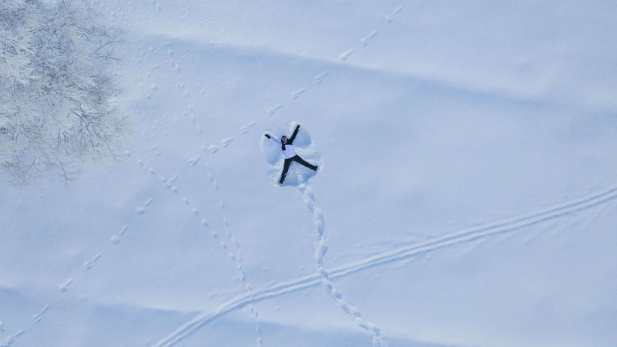 Low angle view of helicopter flying in snow
