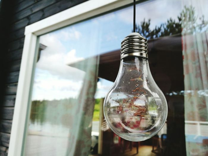 Close-up of light bulb at home