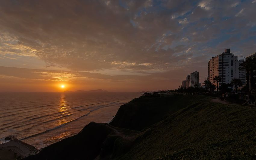 Peru sunset Sky Sunset Cloud - Sky Water Architecture Beach Building Exterior Built Structure Scenics - Nature Land Sea No People Nature City Outdoors Beauty In Nature Building Horizon Orange Color Horizon Over Water
